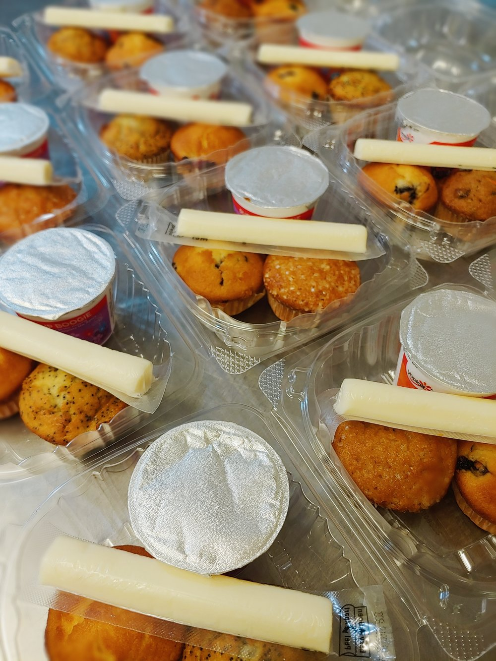 Muffins, cheese, and yogurt boxes
