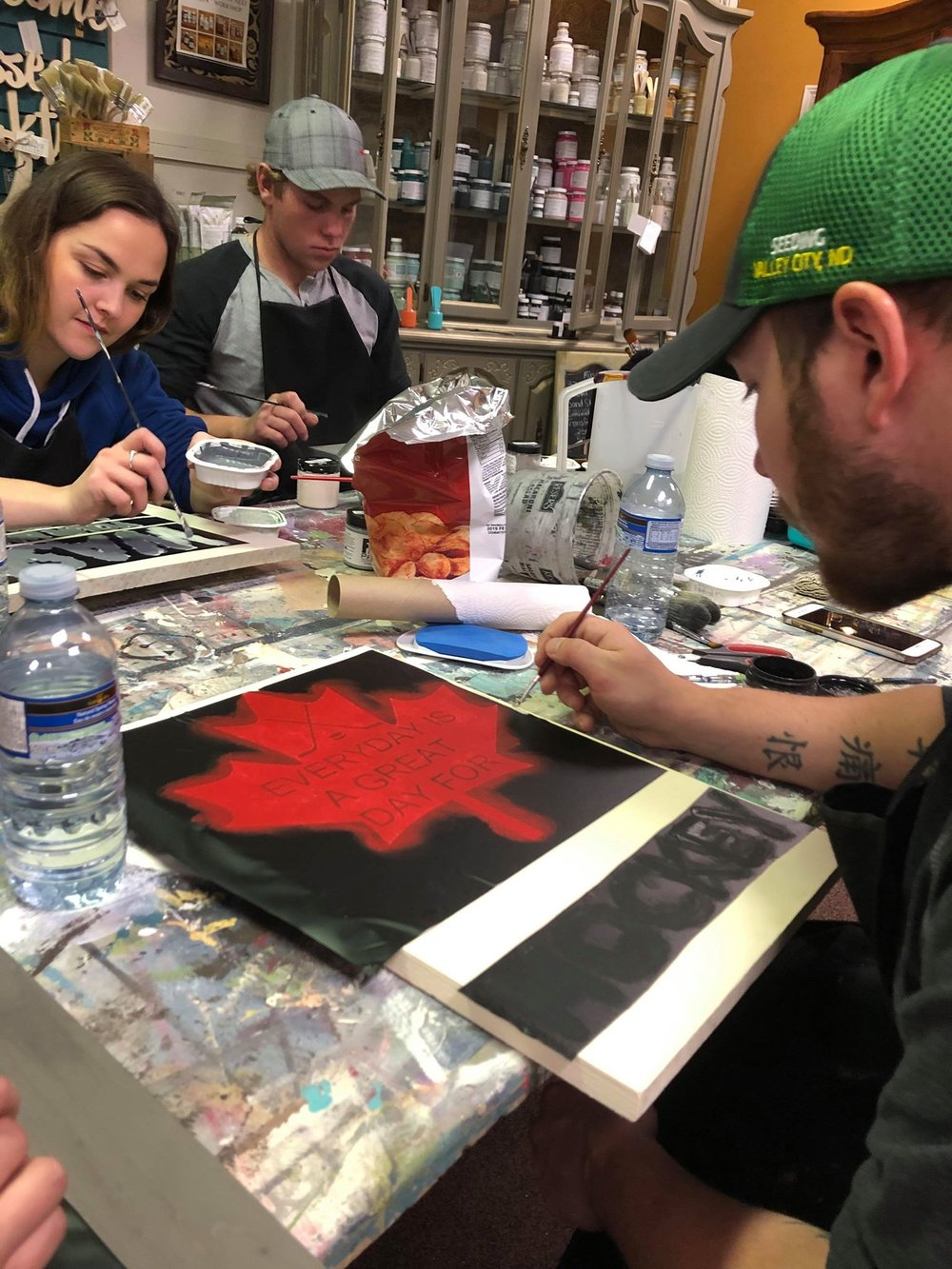 Sign Making - We supply the stencils, paint, brushes, and workspace - you bring your designs and the people!