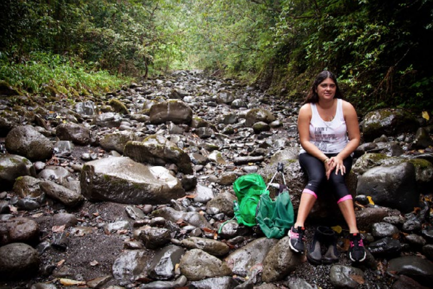 Healoha Carmichael, sits in a bone dry stream bed of Honomanu Stream near her home in East Maui. Honomanu is one of the streams that has been restored through the Water Code.