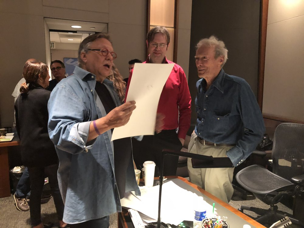 "Composer Arturo Sandoval, Kaska, and Clint Eastwood looking at the score for ""The Mule"""