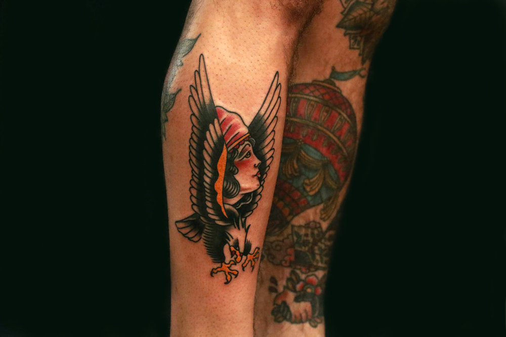 traditional eagle with girl tattoo