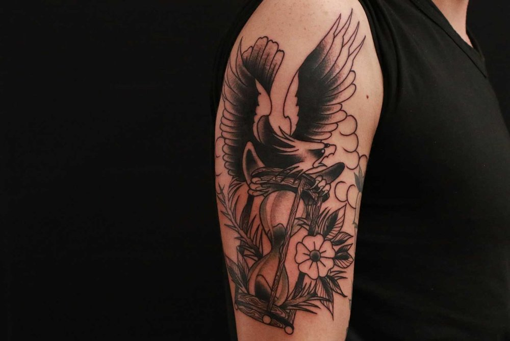 black and grey eagle with hourglass tattoo