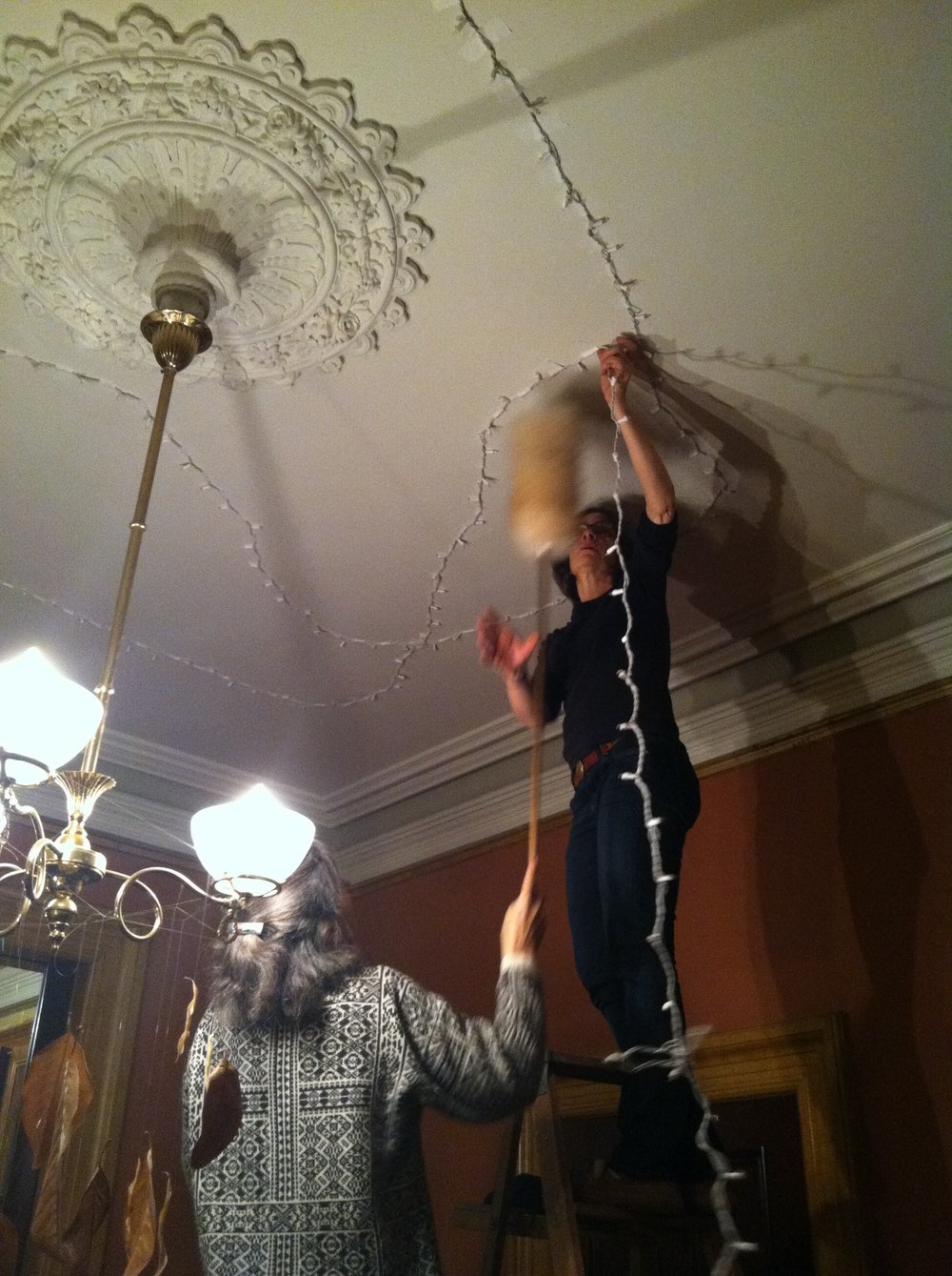 My aunt and mother helping mount lights on the ceiling