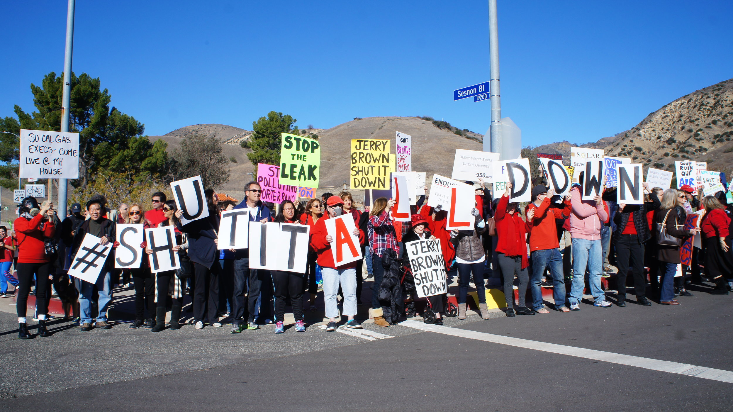 Protestors demand shutdown of nearby natural gas operations.