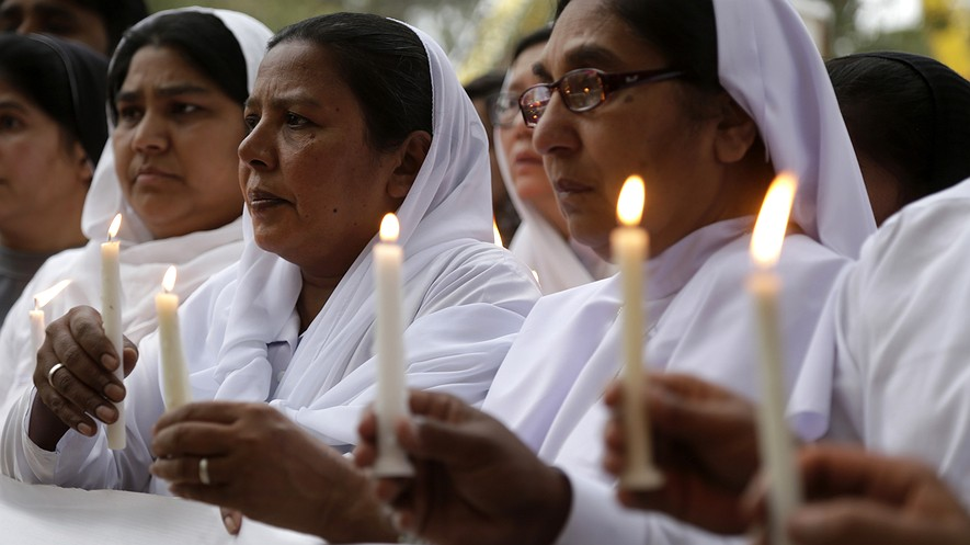 Pakistani nuns hold candles during a vigil for victims of Sunday's deadly suicide bombing in a park, Monday, March 28, 2016 in Lahore, Pakistan. (AP Photo/K.M. Chaudary)