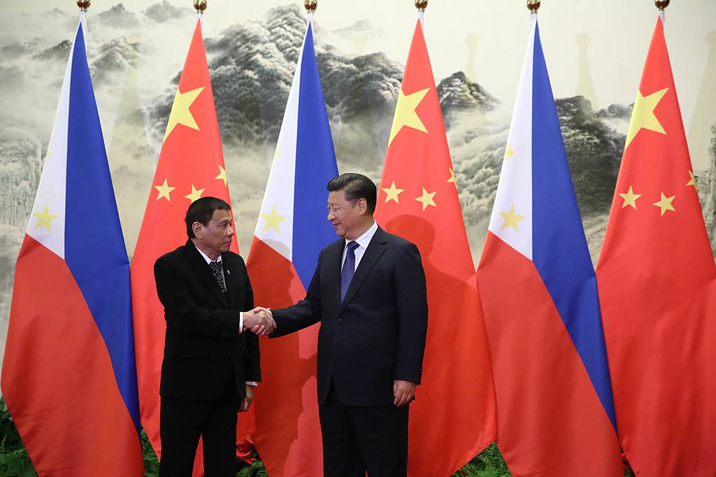 President Rodrigo Roa Duterte and People's Republic of China President Xi Jinping shake hands prior to their bilateral meetings at the Great Hall of the People in Beijing on October 20. Photo by King Rodriguez/PPD