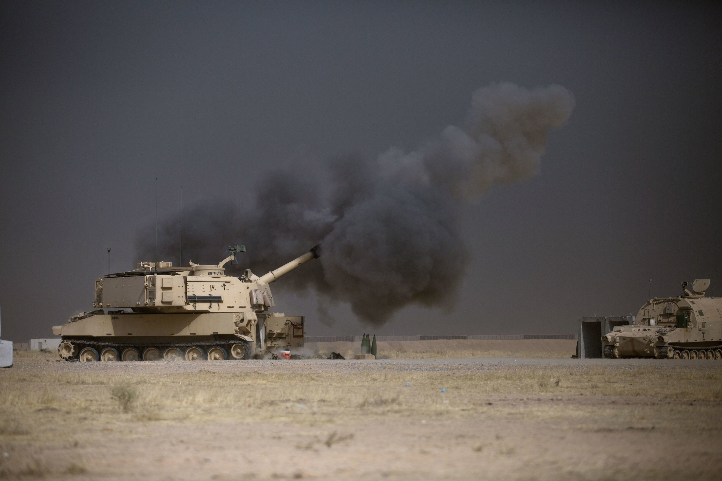 A U.S. Army M109A6 Paladin conducts a fire mission at Qayyarah West, Iraq, in support of the Iraqi security forces' push toward Mosul, Oct. 17, 2016. (U.S. Army photo by Spc. Christopher Brecht)