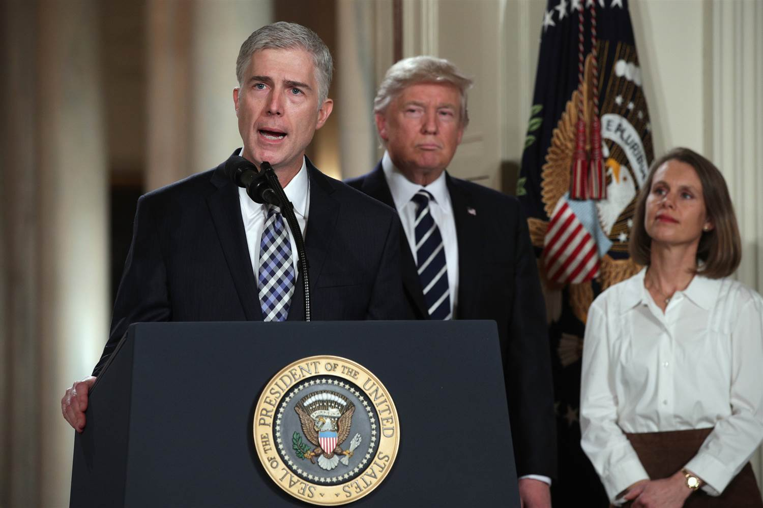 Judge Neil Gorsuch delivers remarks after being nominated by President Donald Trump to the Supreme Court with his wife Marie Louise Gorshuch during a ceremony in the East Room of the White House on Jan. 31, 2017. (Alex Wong / Getty Images)