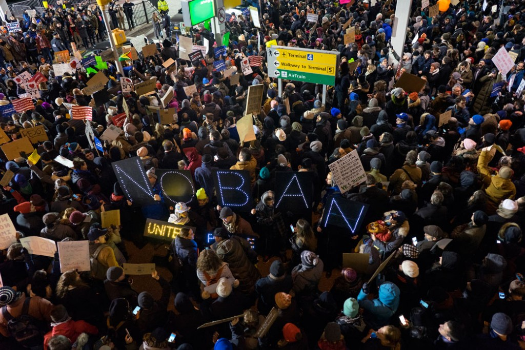 Protesters assemble at John F. Kennedy International Airport in New York, Saturday, January 28, 2017, after two Iraqi refugees were detained while trying to enter the country. (AP/Craig Ruttle)