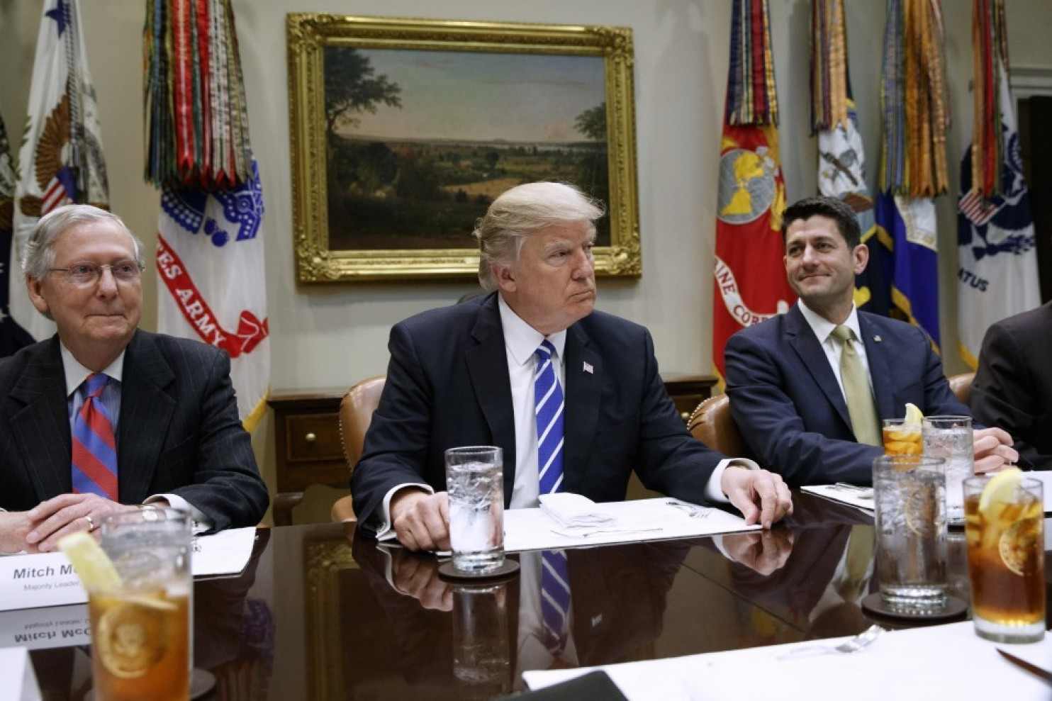 President Trump, flanked by Senate Majority Leader Mitch McConnell and House Speaker Paul D. Ryan, holds a meeting in the White House. (Evavn Vucci/AP)