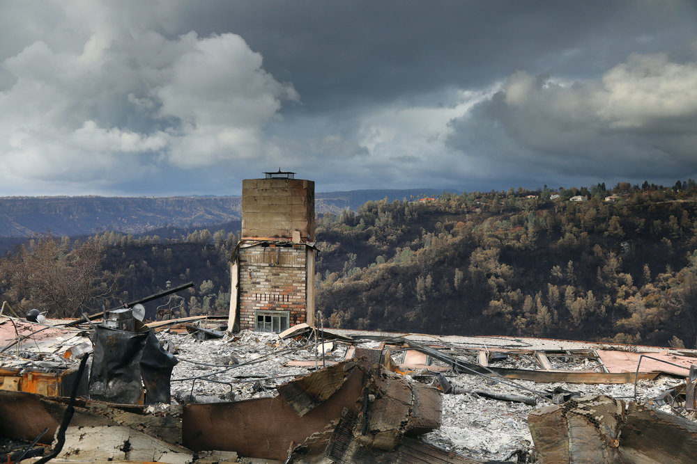 A lone chimney standing at the site of the Camp Fire. (Jim Wilson/New York Times.)