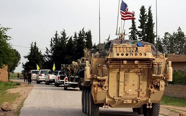 U.S. forces accompanied by members of the Kurdish People's Protection Units. (Delil Souleiman/AFP.)