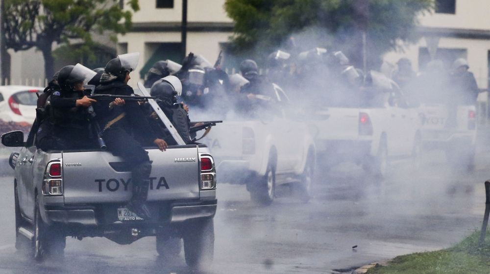 Police shoot at student protesting against Daniel Ortega. (Esteban Felix/AP.)