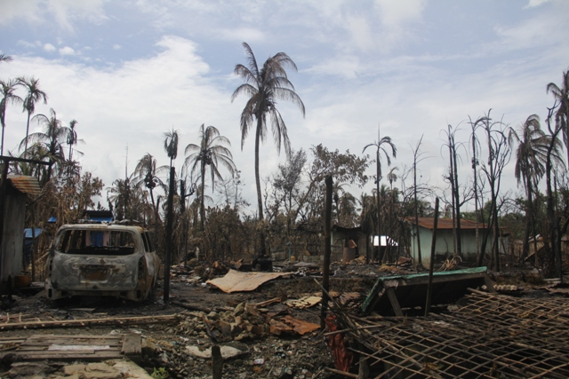 Burnt down houses in a Rohingya village in Rakhine State after clashes in August 2017. (Moe Zaw/Wikimedia Commons)