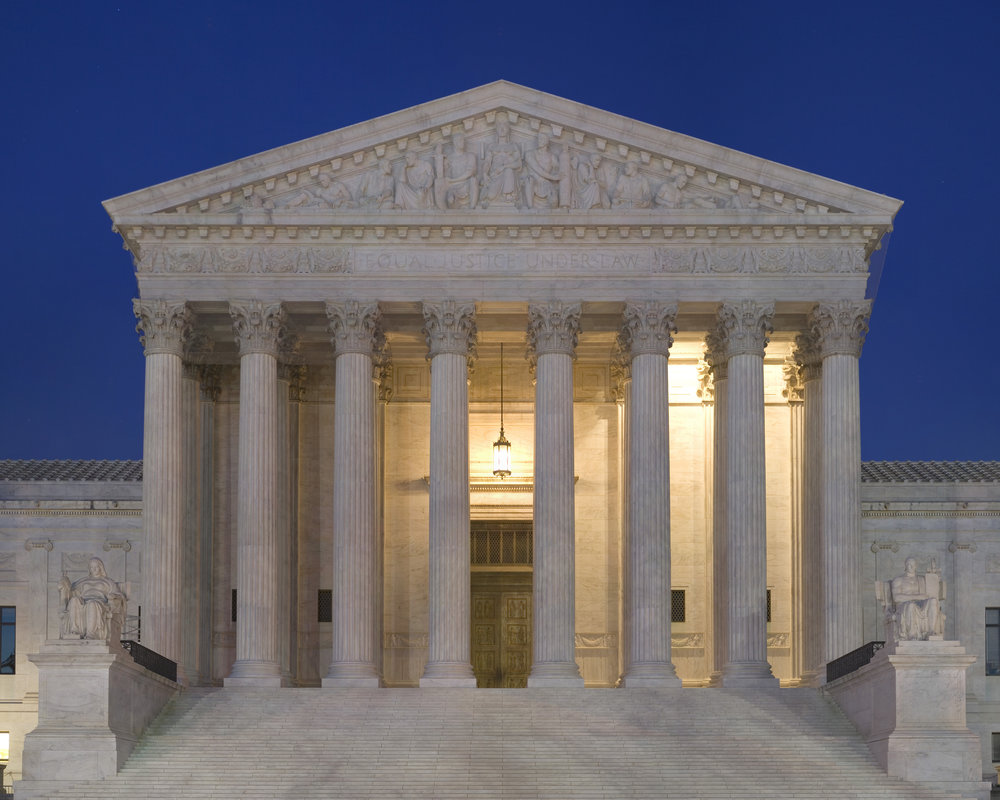 The Supreme Court building at dusk. (Unattributed/Wikimedia Commons)