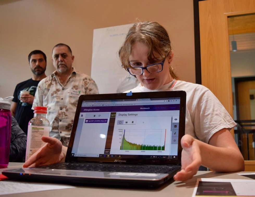 """IDATA student demonstrating Afterglow 2.0, also called """"Afterglow Access"""", for its accessibility features."""