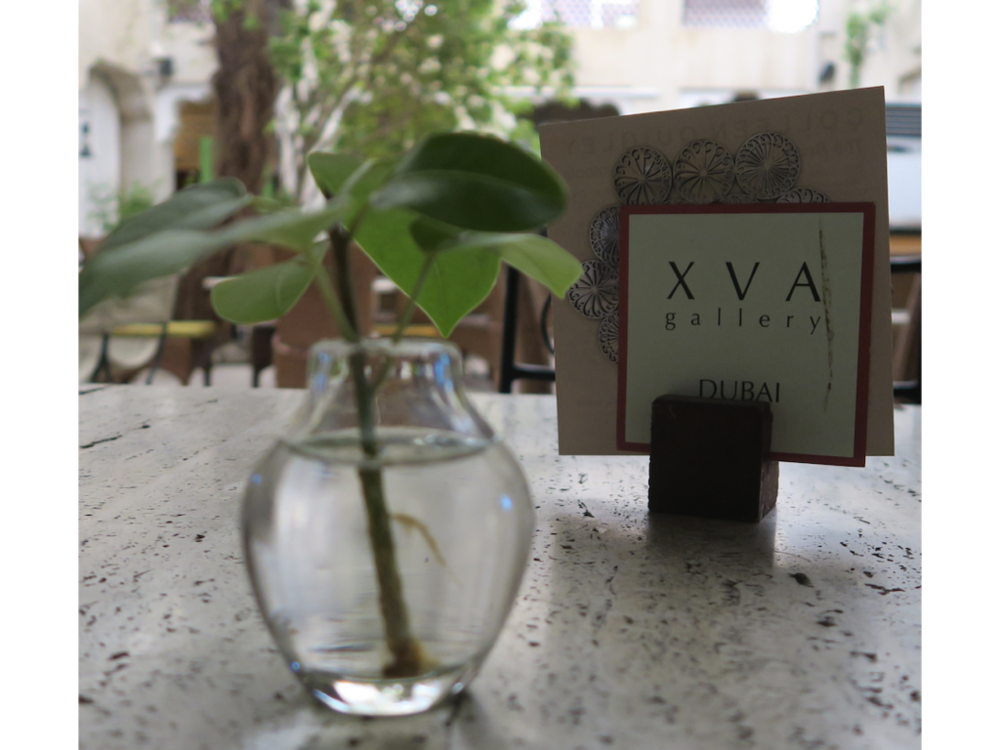 XVA Hotel: Staff routinely take clippings off the tree in the courtyard at the XVA Art Hotel so that the cuttings can root in small vases of water on each table. When the branches begin to grow their own roots, the hotel offers the budding young tree to departing guests. In effect XVA has extended its brand's roots, literally, all over the world.