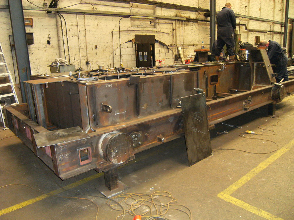 Power generator underbase with built in oil stoarge tanks