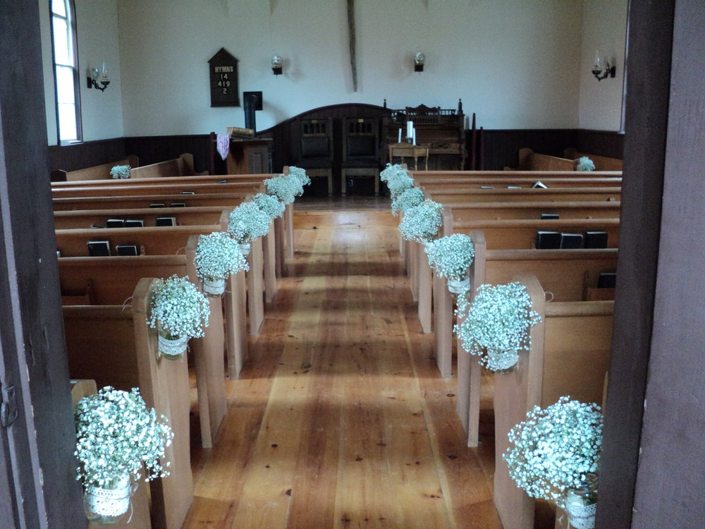 Indoor Ceremony - The century old Fairbairn Church is an intimate ceremony venue. It offers hardwood floors, gas fireplace, oil lamps, lovely wooden pews, and a high pulpit. Capacity: 120
