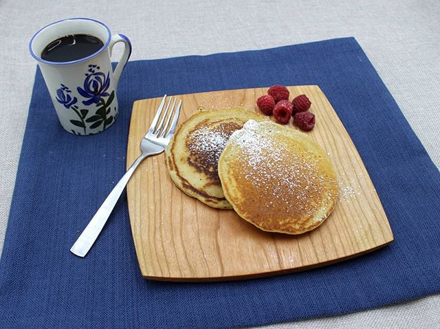 "Oh, hello weekend. Nice to see you again! I love slow mornings with a delicious breakfast, but why wait for Saturday morning? We decided to welcome the weekend tonight with breakfast for dinner. Always a hit with the kiddos and I won't kid myself...coffee is a great Friday night tool in my mid 30's. 🤣 These pancakes are displayed on our 9"" square plate. Check them out in our shop. Link in bio ⬆️."