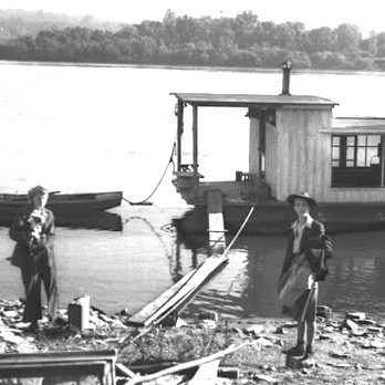 Harlan and Anna Hubbard's Shantyboat at Fort Thomas, Ky., 1944  Black and white photograph,  Contributed by John Morgan  to the Ohio River Portrait Project, 1990PH2  Kentucky Historical Society