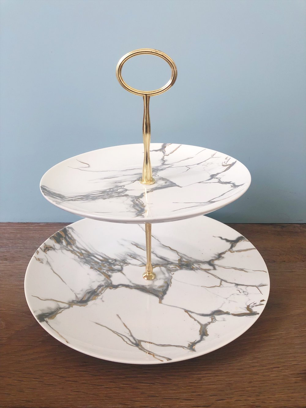 cake plates/tiers - These items have increasingly become popular, and sometimes not just for holding a cake! It's a great way to display similar items, like olive oil and vinegar in the kitchen, or a creative way of displaying a charcuterie board on a three-tiered plate.