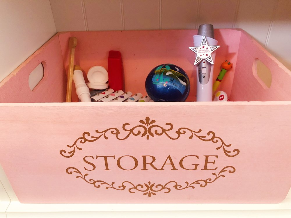 decorative baskets - You can store just about anything in visually pleasing boxes. I have some of these pretty boxes for my kids keepsakes. It's a fun change from the regular (and basic) clear container.