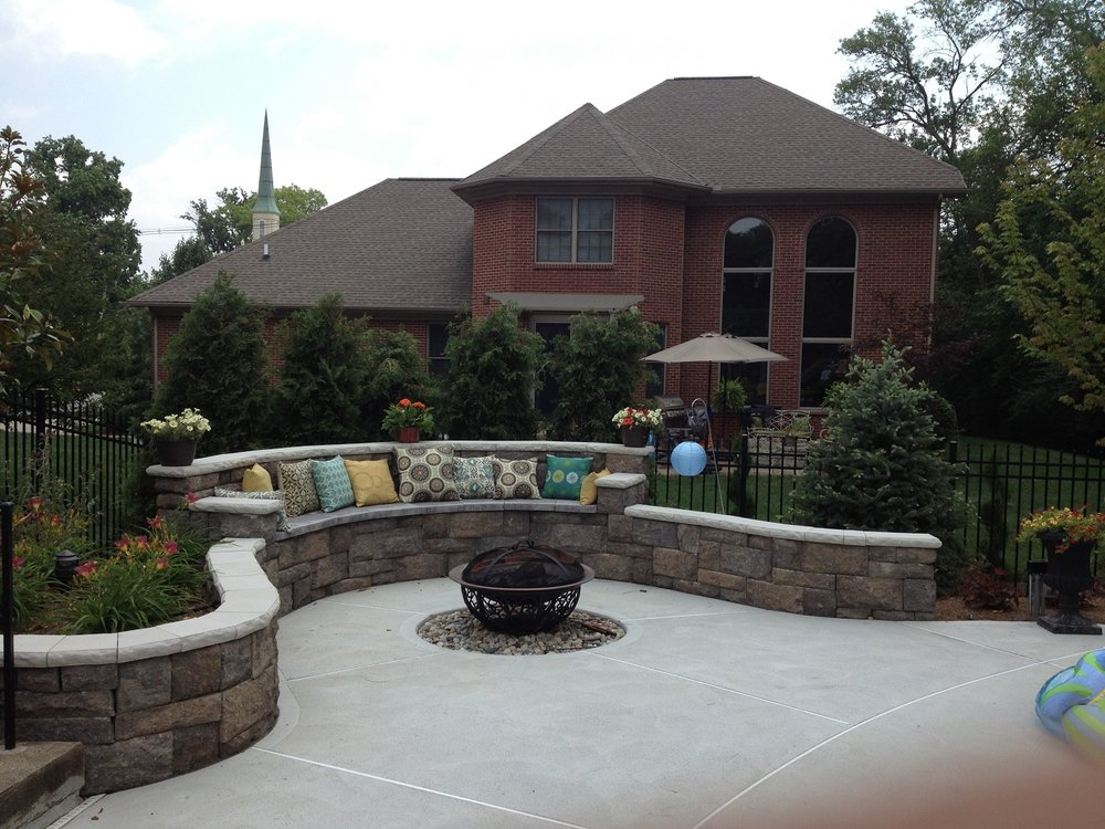 Custom pool patio in West Chester with retaining wall and water features