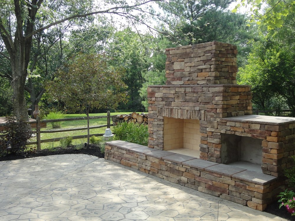 Paver patio in West Chester, OH with outdoor fireplace
