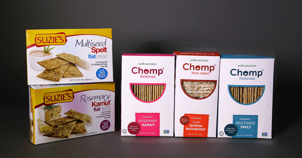 On the left is Good Groceries Suzie's® brand and on the right is the brand revamp, Chomp®.