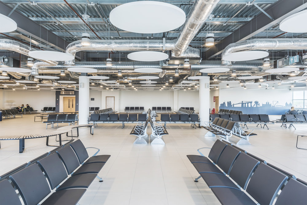 ARCHITECTURAL LIGHTING SCHEME FOR DEMANDING ENVIRONMENTS. - CARDIFF AIRPORT, CARDIFF.