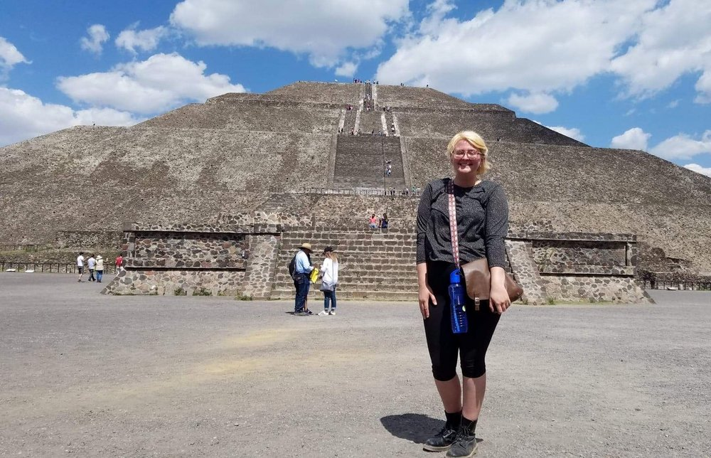 Me, reusable water and red face included, after climbing the Pyramid of the Sun in Teotihuacan.