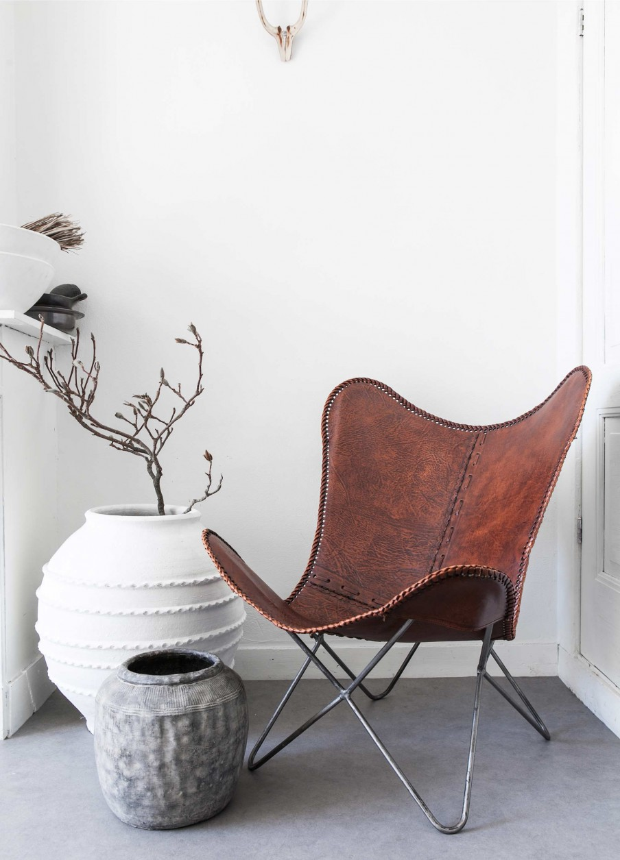 Beautiful leather butterfly chair in this Scandinavian inspired home