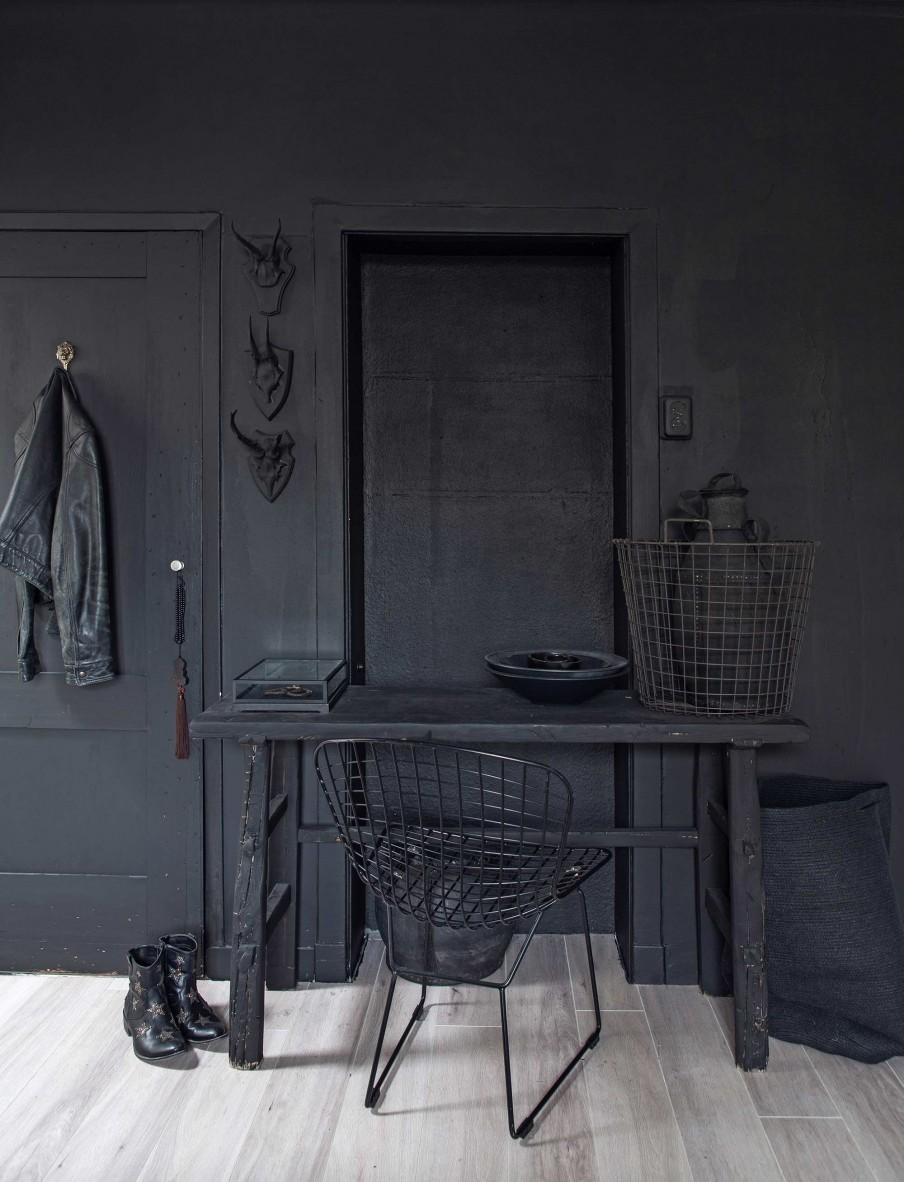 Striking black painted bedroom with Bertoia chair