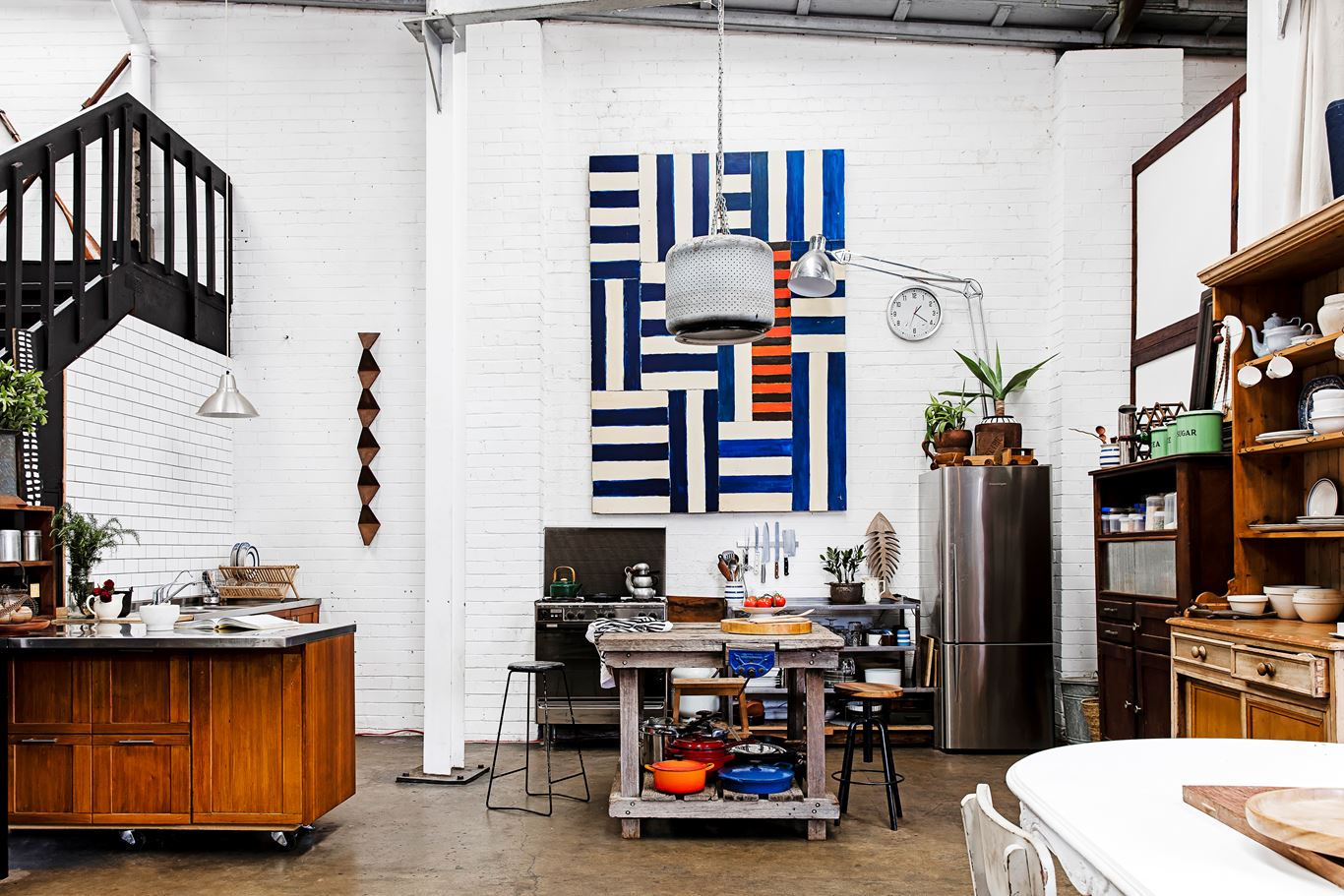 Industrial boho warehouse in Sydney furnished on a shoestring from cleverly upcycled items. Take the tour...