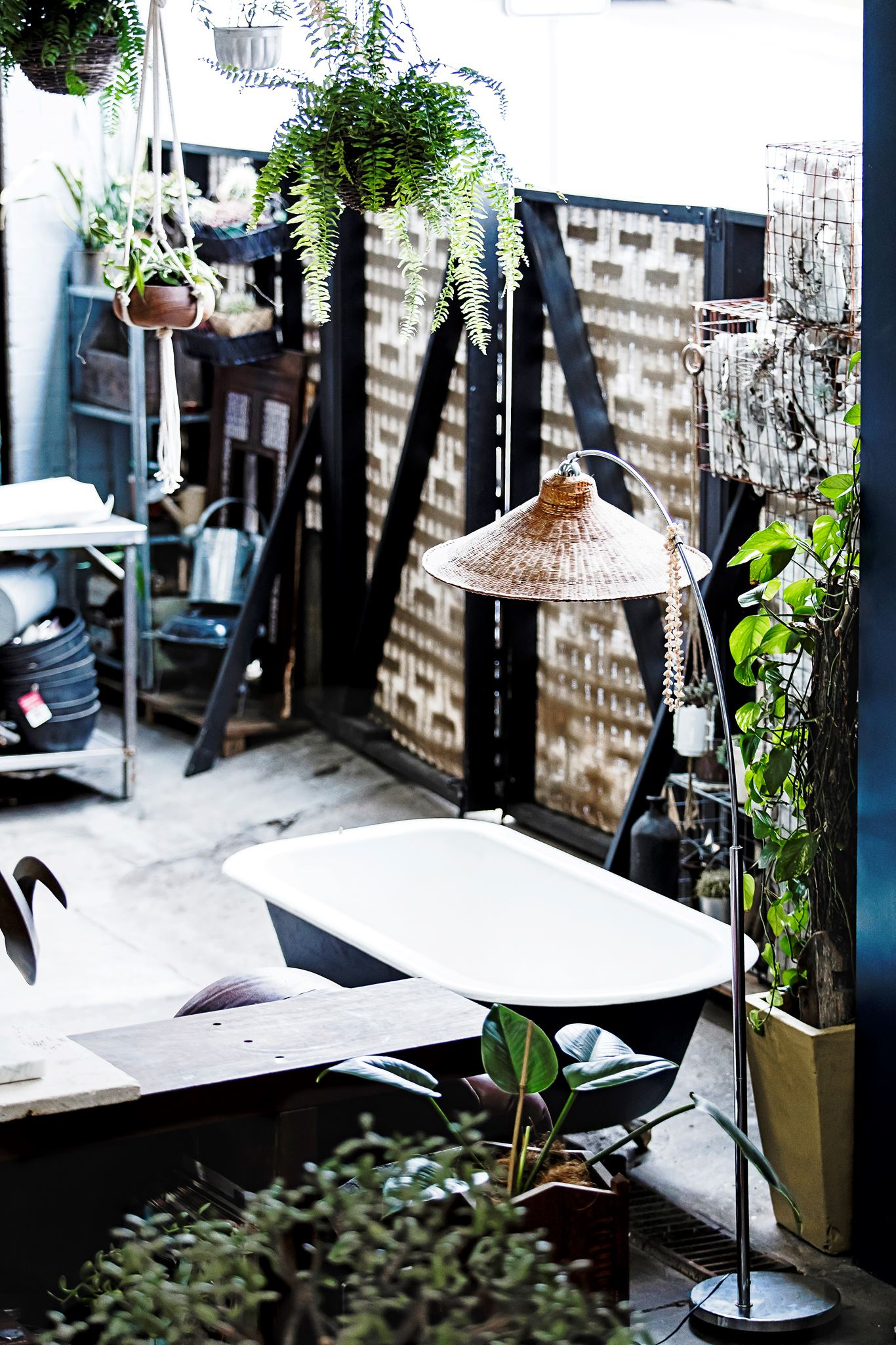 the outdoor space in this Industrial boho warehouse in Sydney furnished on a shoestring from cleverly upcycled items. Take the tour...