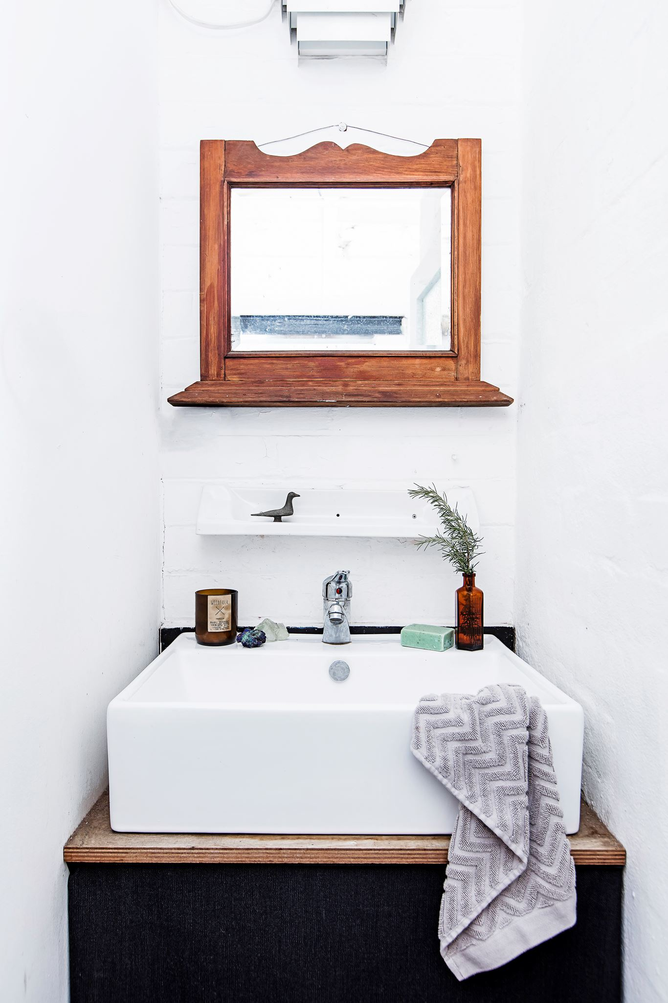 the bathroom in this Industrial boho warehouse in Sydney furnished on a shoestring from cleverly upcycled items. Take the tour...