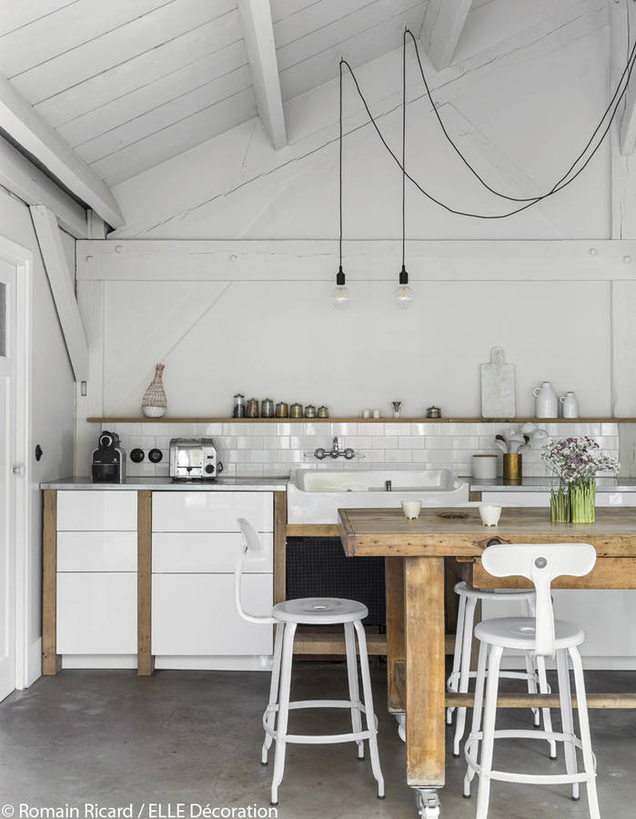 Concrete floors, Ikea cupboards fitted with reclaimed wood in this French loft.