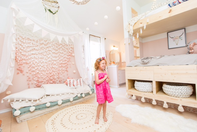 The palest of pink walls for the girls room in this warm, cozy, Scandinavian inspired home in Texas with wooden floors and white walls.