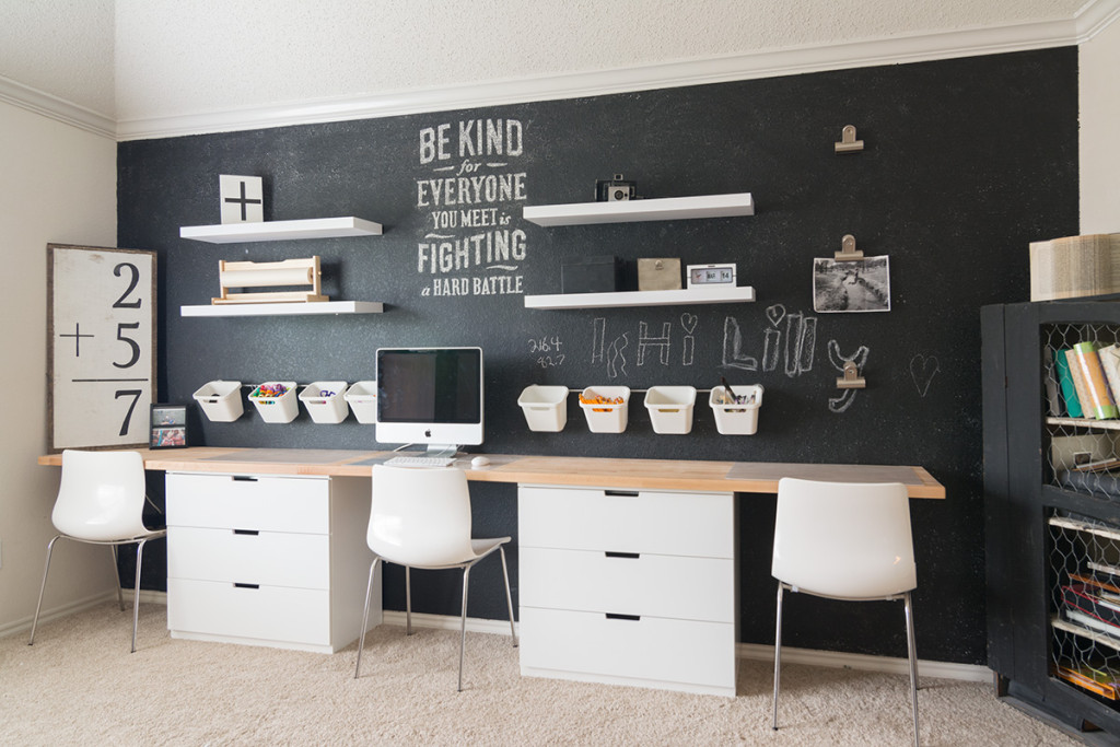 Blackboard wall in the kids room of this warm, cozy, Scandinavian inspired home in Texas with wooden floors and white walls.