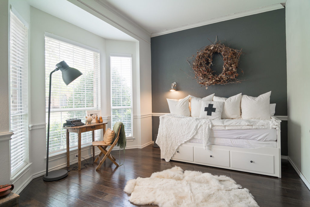 Warm, cozy, Scandinavian inspired home in Texas with wooden floors and white walls.