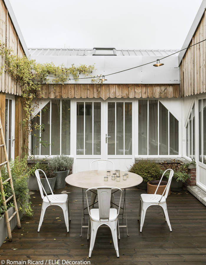 The patio was created from scratch in this French loft including all the windows now overlooking this outdoor space.