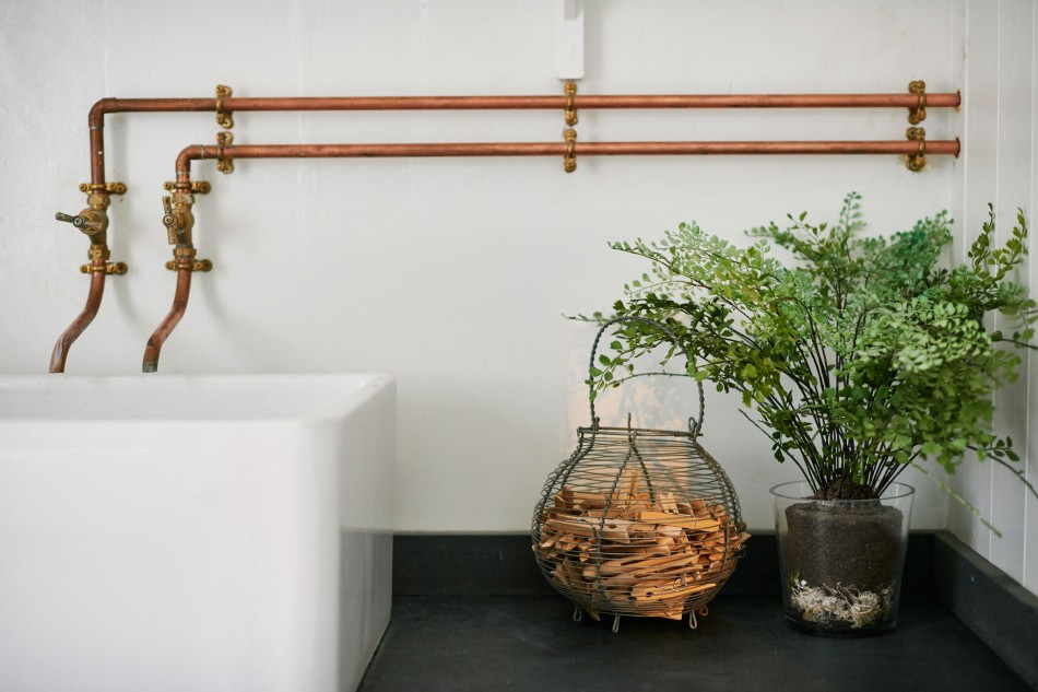 In the utility area I love the bespoke fittings formed from copper piping