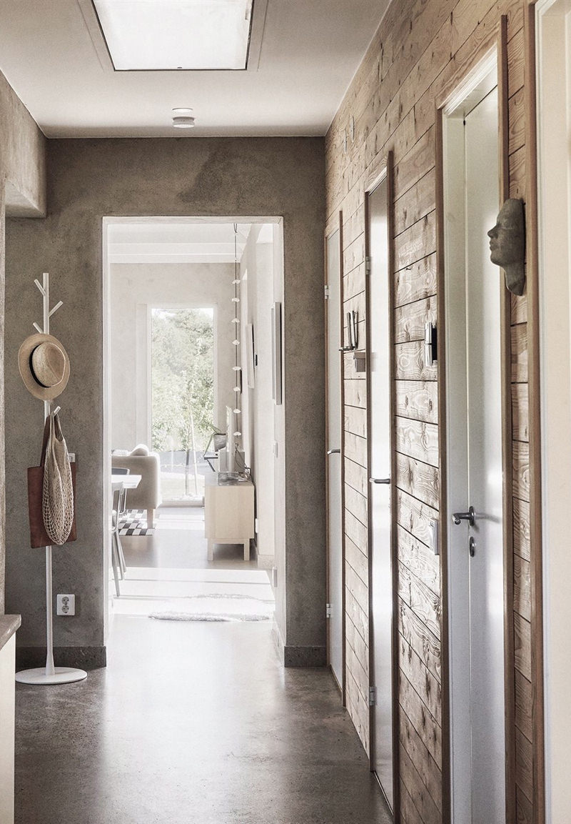 The concrete floor in the hallway is both a practical and beautiful option