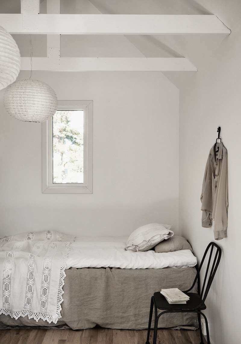 Minimalist bedroom with abundant use of natural tones in line with the rest of the house.