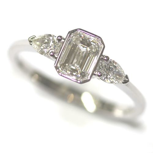 Platinum Pear and Emerald Cut Diamond Trilogy Engagement Ring.jpg