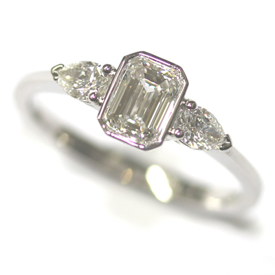 Platinum Pear and Emerald Cut Diamond Trilogy Engagement Ring 1.jpg