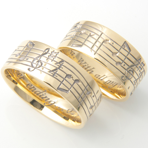 Musical Notes Hand Engraved Wedding Rings.jpg