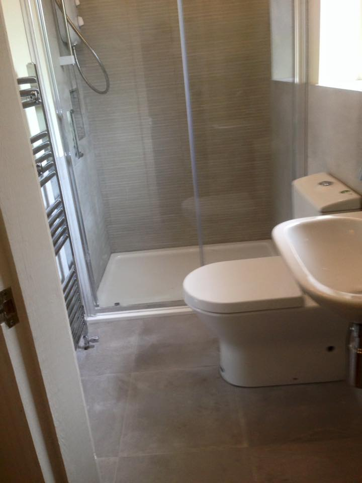 Bathroom renovation- sink-toilet - shower - tiled floor.jpg