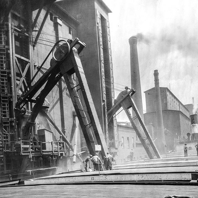 Large Sawyer System in action next to the Globe. Images courtesy of Duluth Public Library.  #wroughtiron #architecturaliron #forgedinfire #oldglobewood #oldglobeironworks #blades #bladesmith #blacksmith #history #historyporn #forge